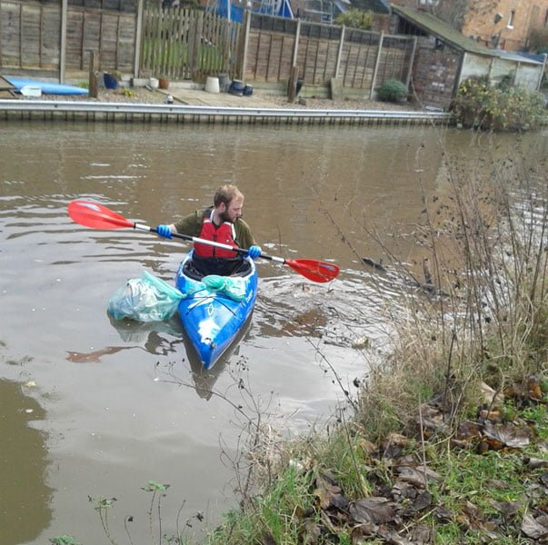 Dan collecting litter from the canal
